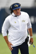 Georgia Tech head coach Geoff Collins speaks to players during the first half of an NCAA college football game against The Citadel, Saturday, Sept. 14, 2019, in Atlanta. (AP Photo/Mike Stewart)