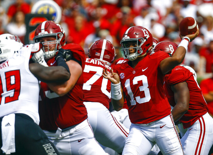 FILE - In this Sept. 8, 2018, file photo, Alabama quarterback Tua Tagovailoa (13) throws a pass during the first half of an NCAA college football game against Arkansas State in Tuscaloosa, Ala. Tagovailoa has been one of the nation's most electric quarterbacks, flinging one touchdown pass after another without a single interception. Grant Delpit and the LSU defensive backs welcome the challenge on Saturday. (AP Photo/Butch Dill, File)