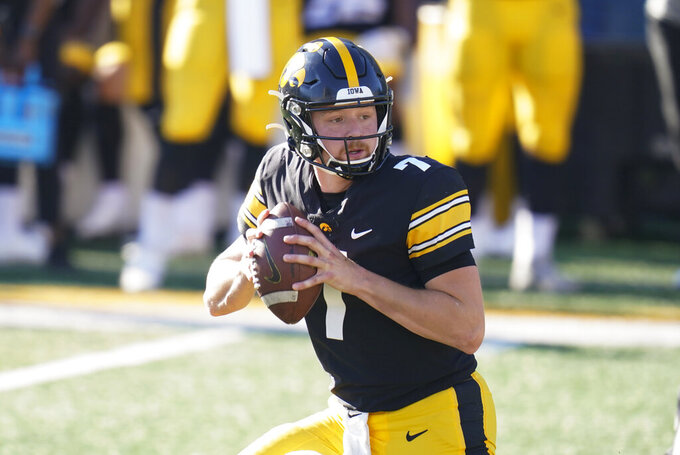 Iowa quarterback Spencer Petras throws a pass during the second half of an NCAA college football game against Michigan State, Saturday, Nov. 7, 2020, in Iowa City, Iowa. Iowa won 49-7. (AP Photo/Charlie Neibergall)