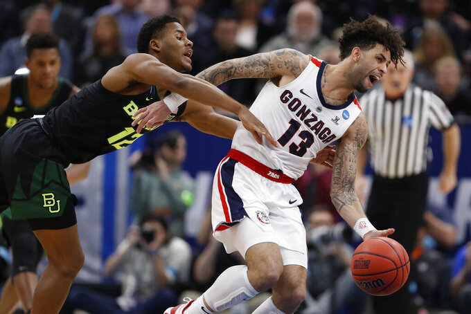 Baylor guard Jared Butler (12) fouls Gonzaga guard Josh Perkins (13) during the first half of a second-round game in the NCAA men's college basketball tournament Saturday, March 23, 2019, in Salt Lake City. (AP Photo/Jeff Swinger)