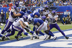 New York Giants running back Jon Hilliman (28) is tackled in the end zone by the Minnesota Vikings for a safety during the second quarter of an NFL football game, Sunday, Oct. 6, 2019, in East Rutherford, N.J. (AP Photo/Bill Kostroun)
