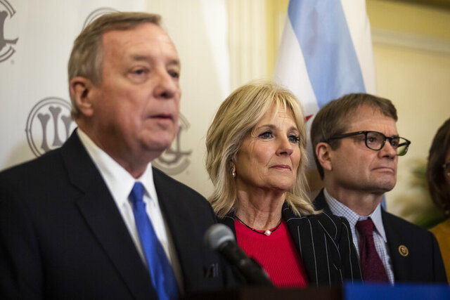 Former Second Lady of the United States Jill Biden and U.S. Rep. Mike Quigley, right, look on as U.S. Sen. Dick Durbin endorses former Vice President Joe Biden during a press conference at the Union League Club, Friday, March 6, 2020. (Ashlee Rezin Garcia/Chicago Sun-Times via AP)