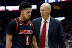Louisville head coach Chris Mack, right, talks with Louisville guard Lamarr Kimble during the second half of an NCAA college basketball game against Western Kentucky Friday, Nov. 29, 2019, in Nashville, Tenn. (AP Photo/Mark Zaleski)
