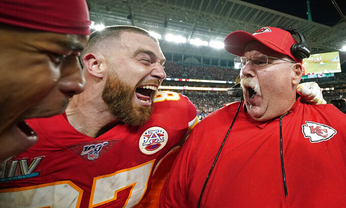 Kansas City Chiefs' Travis Kelce, left, celebrates with head coach Andy Reid after defeating the San Francisco 49ers in the NFL Super Bowl 54 football game on Feb. 2, 2020, in Miami Gardens, Fla. (AP Photo/David J. Phillip)