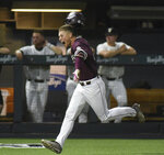 Mississippi State's Elijah MacNamee runs home after hitting a two-run home run in the ninth inning for a 10-8 win over Vanderbilt during an NCAA college baseball tournament super regional game Friday, June 8, 2018, in Nashville, Tenn. (AP Photo/Mike Strasinger)