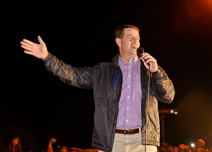 Clemson coach Dabo Swinney speaks to fans who gathered for the return of the team to campus Tuesday, Jan. 8, 2019, in Clemson, S.C., the day after the Tigers defeated Alabama 44-16 in the College Football Playoff championship game. (AP Photo/Richard Shiro)