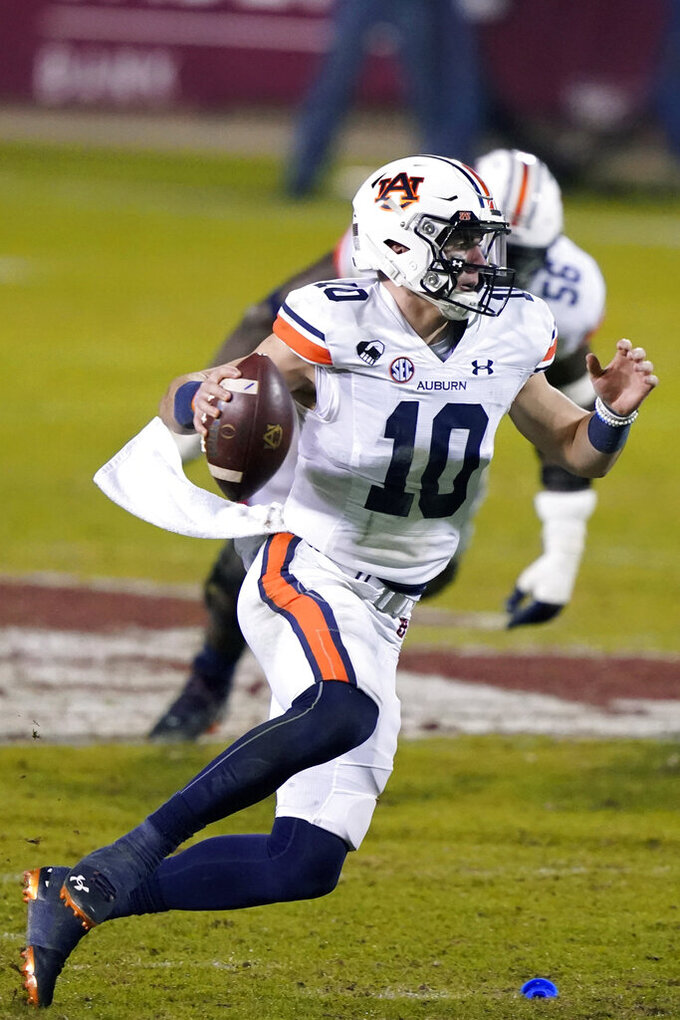 Auburn quarterback Bo Nix scrambles during the second half of the team's NCAA college football game against Mississippi State on Saturday, Dec. 12, 2020, in Starkville, Miss. (AP Photo/Rogelio V. Solis)
