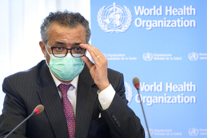 """FILE - In this Monday, May 24, 2021 file photo, Tedros Adhanom Ghebreyesus, Director General of the World Health Organization (WHO), speaks during a bilateral meeting with Swiss Interior and Health Minister Alain Berset before signing a BioHub Initiative with a global Covid-19 Pathogen repository in Spiez laboratory on the sideline of the opening of the 74th World Health Assembly, WHA, at the WHO headquarters, in Geneva, Switzerland. The head of the World Health Organization said at a press briefing on Friday June 25, 2021, the COVID-19 delta variant, first seen in India, is """"the most transmissible of the variants identified so far,"""" and warned it is now spreading in at least 85 countries. (Laurent Gillieron/Keystone via AP, File)"""