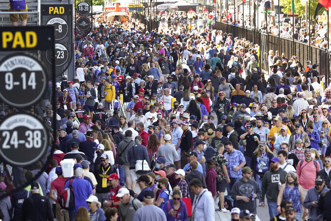 Fans enter the Indianapolis Motor Speedway before the Indianapolis 500 auto race in Indianapolis, Sunday, May 30, 2021. (AP Photo/Paul Sancya)