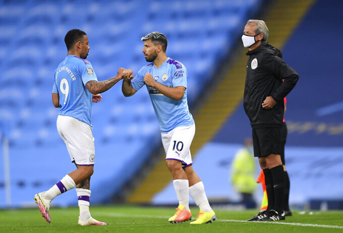Manchester City's Gabriel Jesus, left, is replaced by Sergio Aguero during the English Premier League soccer match between Manchester City and Arsenal at the Etihad Stadium in Manchester, England, Wednesday, June 17, 2020. The English Premier League resumes Wednesday after its three-month suspension because of the coronavirus outbreak. (AP photo/Dave Thompson, Pool)