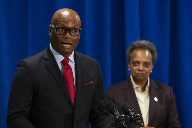 Former Dallas Police Chief David Brown, left, speaks to reporters after Mayor Lori Lightfoot, right, nominated him to be Chicago's next police superintendent Thursday, April 2, 2020. (Tyler LaRiviere/Chicago Sun-Times via AP)