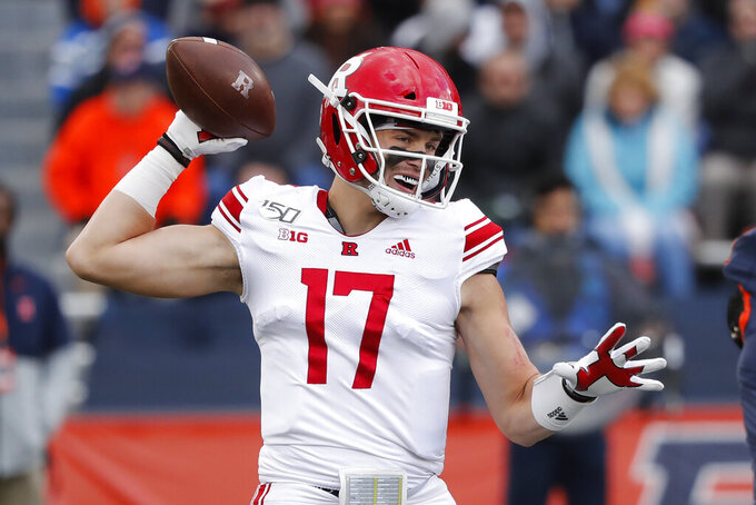 Rutgers quarterback Johnny Langan passes during the first half of an NCAA college football game against Illinois, Saturday, Nov. 2, 2019, in Champaign, Ill. (AP Photo/Charles Rex Arbogast)