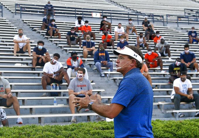 Auburn coach Gus Malzahn talks to players during the first team meeting of the season for the NCAA college football team, Sunday, Aug. 16, 2020, in Auburn, Ala. (AP Photo/Todd Van Emst via AP)