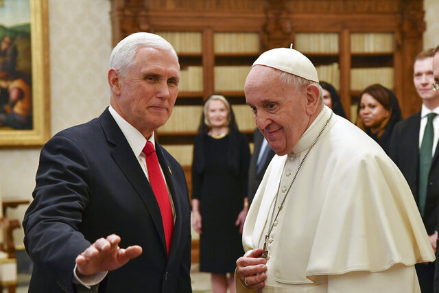 "Pope Francis meets with US Vice President Mike Pence, left, on the occasion of their private audience, at the Vatican, Friday, Jan. 24, 2020. Pence told Pope Francis, ""You made me a hero"