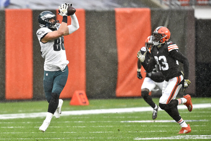 Philadelphia Eagles tight end Dallas Goedert (88) catches a pass against Cleveland Browns defensive back Ronnie Harrison (33) during the first half of an NFL football game, Sunday, Nov. 22, 2020, in Cleveland. (AP Photo/David Richard)