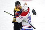 Boston Bruins left wing Brad Marchand, left, and Montreal Canadiens defenseman Jeff Petry (26) fight during the first period of an NHL hockey game in Boston, Wednesday, Feb. 12, 2020. (AP Photo/Charles Krupa)