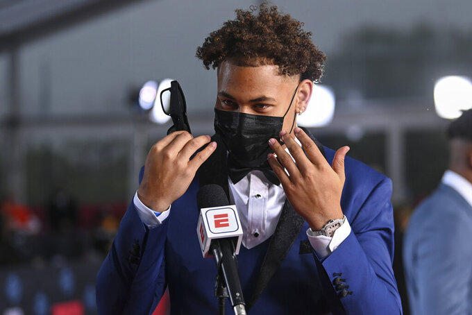 North Dakota State quarterback Trey Lance appears on the red carpet at the Rock & Roll Hall of Fame before the NFL football draft Thursday, April 29, 2021, in Cleveland. (AP Photo/David Dermer, Pool)