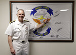 U.S. Vice Adm. Phillip Sawyer, commander of the U.S. Seventh Fleet, points to his autograph on the Seventh Fleet flag which is displayed aboard the USS Blue Ridge during an interview aboard the ship Monday, March 18, 2019 at Manila's South Harbor. in Manila, Philippines. The flag was was planted on Mt. Everest and is now displayed aboard the Seventh Fleet flagship. (AP Photo/Bullit Marquez)