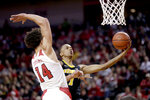Iowa's Maishe Dailey (1) goes for a layup which was blocked by Nebraska's Isaiah Roby (14) during the first half of an NCAA college basketball game in Lincoln, Neb., Sunday, March 10, 2019. (AP Photo/Nati Harnik)