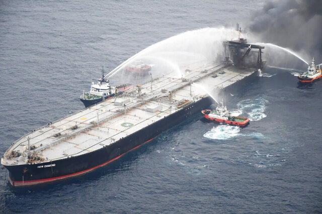 FILE- A Sept. 8, 2020 file photo released by Sri Lankan Air Force shows ships fighting fire on the MT New Diamond, about 30 nautical miles off the coast of Sri Lanka. The owner of the large oil tanker that caught fire off Sri Lanka's coast has agreed to pay $1.8 million to the island nation for its help in extinguishing the blaze, an official said Thursday, Sept. 24.(Sri Lankan Air Force via AP, File)