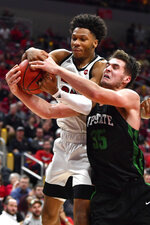 Louisville forward Dwayne Sutton (24) battles South Carolina Upstate center Nevin Zink (35) for a rebound during the second half of an NCAA college basketball game in Louisville, Ky., Wednesday, Nov. 20, 2019. Louisville won 76-50. (AP Photo/Timothy D. Easley)