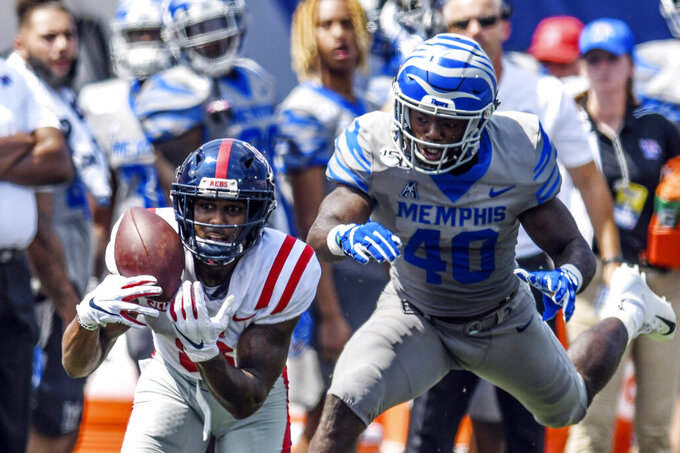 Mississippi wide receiver Elijah Moore, left, makes a catch ahead of Memphis linebacker Thomas Pickens (40) during an NCAA college football game  Saturday, Aug. 31, 2019, in  in Memphis, Tenn. (Bruce Newman/The Oxford Eagle via AP)