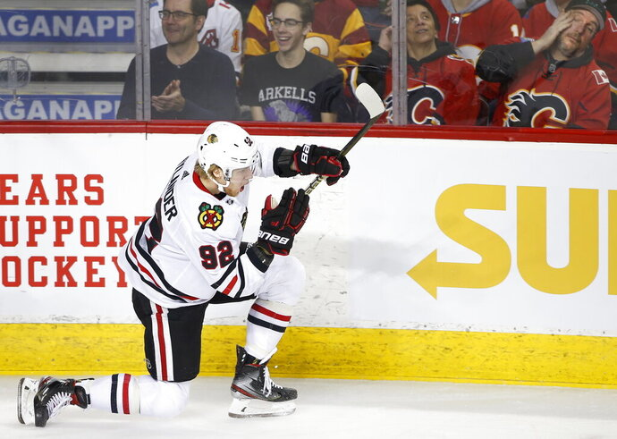 Chicago Blackhawks left wing Alex Nylander (92) celebrates his goal against the Calgary Flames during the second period of an NHL hockey game Saturday, Feb. 15, 2020, in Calgary, Alberta. (Larry MacDougal/The Canadian Press via AP)