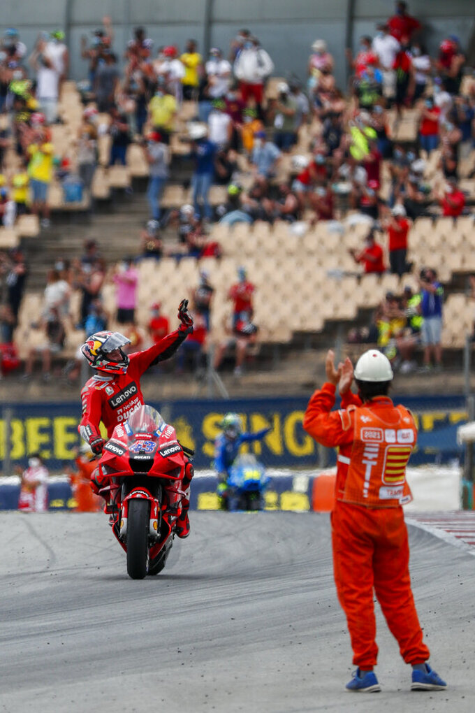 Australia's Jack Miller rides his Ducati at the end of the Catalunya Motorcycle Grand Prix at the Barcelona Catalunya racetrack in Montmelo, near Barcelona, Spain, Sunday, June 6, 2021. (AP Photo/Joan Monfort)