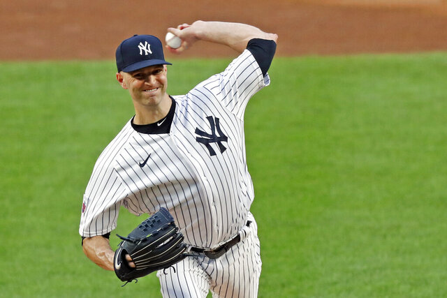 New York Yankees starting pitcher J.A. Happ winds up during the first inning of a baseball game against the Boston Red Sox, Sunday, Aug. 16, 2020, in New York. (AP Photo/Kathy Willens)