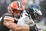 Cleveland Browns defensive end Olivier Vernon (54) sacks Philadelphia Eagles quarterback Carson Wentz (11) in the end zone for a safety during the second half of an NFL football game, Sunday, Nov. 22, 2020, in Cleveland. (AP Photo/David Richard)