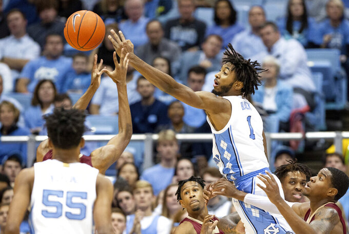 North Carolina's Leaky Black (1) reaches for a rebound during an NCAA college basketball game against Elon in Chapel Hill, N.C., Wednesday, Nov. 20, 2019. (AP Photo/Ben McKeown)