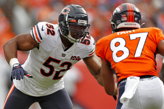 Chicago Bears outside linebacker Khalil Mack (52) pursues Denver Broncos tight end Noah Fant (87) during the second half of an NFL football game, Sunday, Sept. 15, 2019, in Denver. (AP Photo/David Zalubowski)