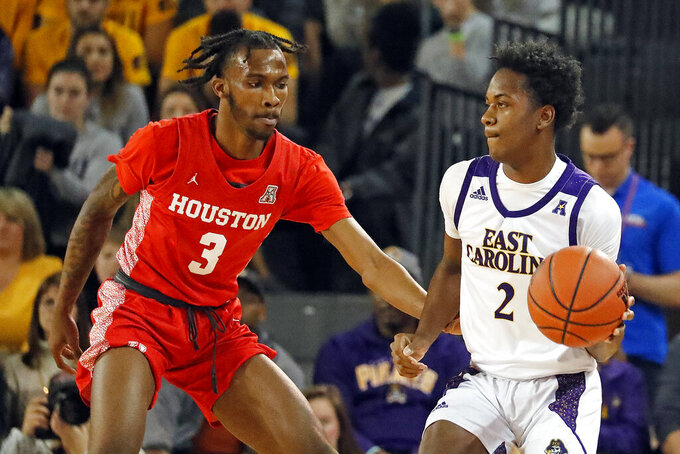 East Carolina's Tristen Newton (2) works the ball against Houston's DeJon Jarreau (3) during the first half of an NCAA college basketball game in Greenville, N.C., Wednesday, Jan. 29, 2020. (AP Photo/Karl B DeBlaker)
