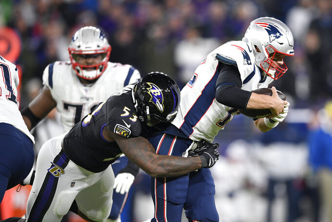 Baltimore Ravens defensive end Jihad Ward (53) sacks New England Patriots quarterback Tom Brady (12) on a third down play in the second half of an NFL football game, Sunday, Nov. 3, 2019, in Baltimore. The Ravens won 37-20. (AP Photo/Nick Wass)