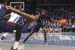 South Carolina State Jahmari Etienne (14) looks to pass while guarded by Memphis' Alex Lomax (2) during the first half of an NCAA college basketball game Tuesday, Nov. 5, 2019, in Memphis, Tenn. (AP Photo/Karen Pulfer Focht)