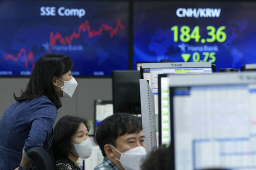 Currency traders watch monitors at the foreign exchange dealing room of the KEB Hana Bank headquarters in Seoul, South Korea, Friday, Oct. 15, 2021. Asian shares were higher Friday after technology companies powered the biggest gain on Wall Street since March. (AP Photo/Ahn Young-joon)