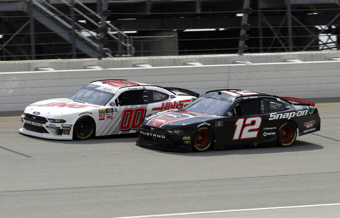 Cole Custer, left, and Joey Logano drive during a NASCAR Xfinity Series auto race at Chicagoland Speedway in Joliet, Ill., Saturday, June 29, 2018. (AP Photo/Nam Y. Huh)