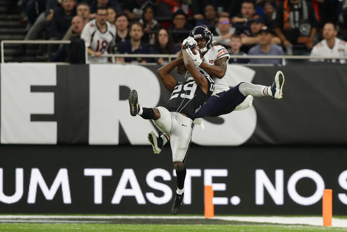 Chicago Bears wide receiver Anthony Miller (17) makes a catch against Oakland Raiders free safety Lamarcus Joyner (29) during the second half of an NFL football game at Tottenham Hotspur Stadium, Sunday, Oct. 6, 2019, in London. (AP Photo/Kirsty Wigglesworth)
