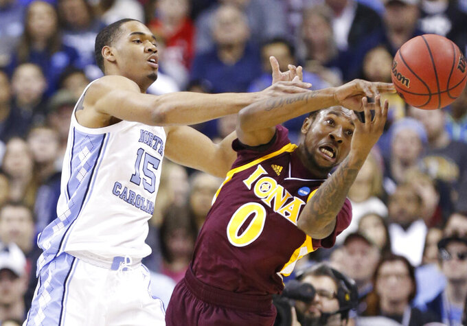 North Carolina's Garrison Brooks (15) and Iona's Rickey McGill (0) battle for the ball in the first half during a first round men's college basketball game in the NCAA Tournament in Columbus, Ohio, Friday, March 22, 2019. (AP Photo/Paul Vernon)