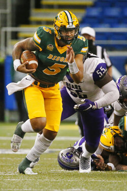 North Dakota State quarterback Trey Lance (5) runs past Central Arkansas defensive lineman Jalen Bedell (55) for a first down in the second quarter of an NCAA college football game Saturday, Oct. 3, 2020, in Fargo, N.D. (AP Photo/Bruce Kluckhohn)