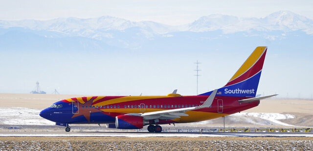 FILE - In this Dec. 31, 2020 file photo, a Southwest Airlines jetliner taxis down a runway for takeoff from Denver International Airport in Denver.  Southwest said Thursday, Jan. 28, 2021, that it lost $3.1 billion last year, its first full-year loss since 1972.  (AP Photo/David Zalubowski, File)