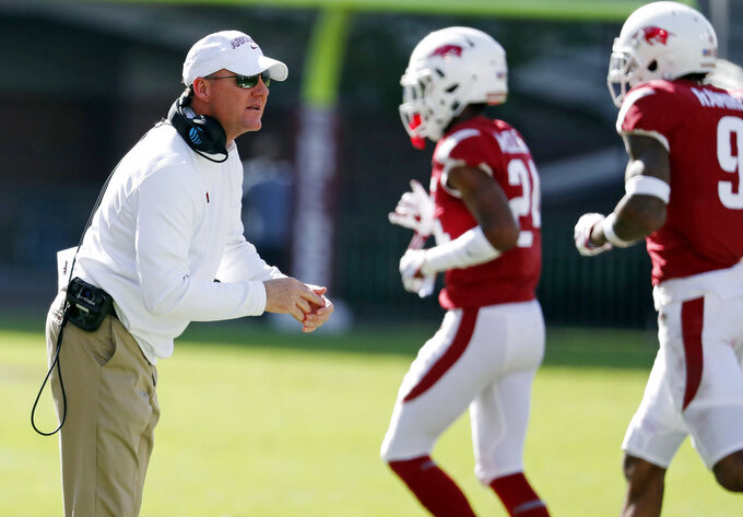 Arkansas head coach Chad Morris encourages his players as they leave the field in the second half of an NCAA college football game against Mississippi State in Starkville, Miss., Saturday, Nov. 17, 2018. Mississippi State won 52-6. (AP Photo/Rogelio V. Solis)