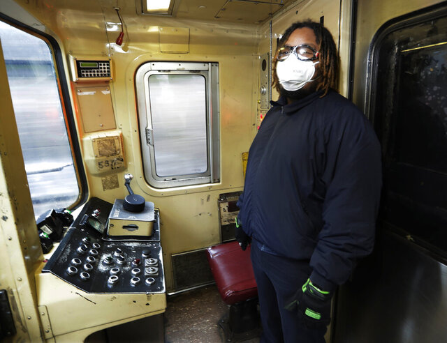 FILE - In this April 30, 2020, file photo, New York City subway conductor Desmond Hill works on the N train in New York. Unions representing New York transit workers are demanding better safety measures and more access to protective gear as more businesses and schools re-open their doors. (AP Photo/Frank Franklin II)
