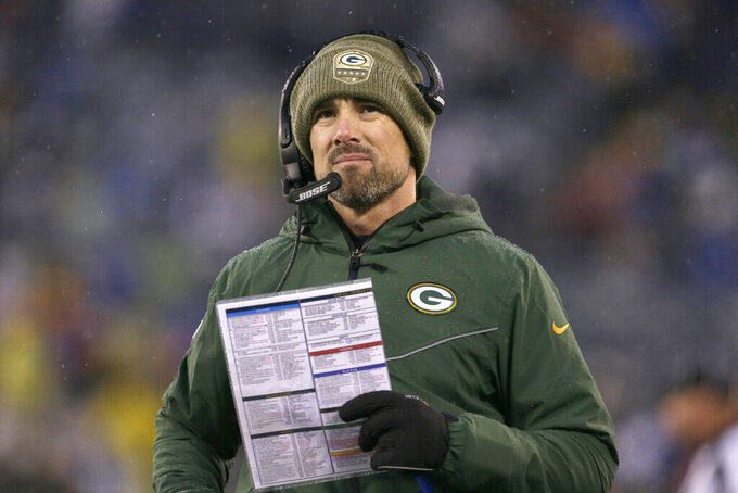 "FILE - In this  Sunday, Dec. 1, 2019 file photo, Green Bay Packers head coach Matt LaFleur watches during the second half of an NFL football game against the New York Giants in East Rutherford, N.J. Matt LaFleur is set to lead the Green Bay Packers against his former club, the Washington Redskins. LaFleur coached quarterbacks for Washington from 2010-13. LaFleur called the tenure the ""foundation"" of his NFL career. (AP Photo/Adam Hunger, File)"