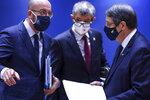 European Council President Charles Michel, left, speaks with Cypriot President Nicos Anastasiades, right, and Czech Republic's Prime Minister Andrej Babis during a round table meeting at an EU summit in Brussels, Friday, Oct. 16, 2020. European Union leaders meet for the second day of an EU summit, amid the worsening coronavirus pandemic, to discuss topics on foreign policy issues. (Kenzo Tribouillard, Pool via AP)