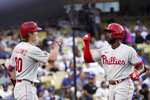 Philadelphia Phillies' Andrew McCutchen, right, is congratulated by Luke Williams after hitting a solo home run during the second inning of a baseball game against the Los Angeles Dodgers Tuesday, June 15, 2021, in Los Angeles. (AP Photo/Mark J. Terrill)