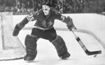 FILE - In this Jan. 25, 1970, file photo, Chicago Blackhawks goalie Tony Esposito moves behind the net to stop the puck for a teammate during an NHL hockey game against the Toronto Maple Leafs in Chicago. Esposito, a Hall of Fame goaltender who played almost his entire 16-year career with the Blackhawks, has died following a brief battle with pancreatic cancer, the team announced Tuesday, Aug. 10, 2021. He was 78.  (AP Photo/Fred Jewell, File)