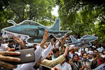 FILE - In this Aug. 30 2018 file photo, Congress party workers shout slogans during a protest against the Indian government's deal to buy Rafale fighter jets from France, in New Delhi, India. India's defense minister is travelling to Paris Thursday Oct.11, 2018 amid controversy over a multi-billion dollar deal in which France will sell 36 fighter jets to India. (AP Photo/Manish Swarup)