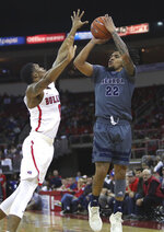 Nevada's Jazz Johnson shoots over Fresno State's New Williams during the first half of an NCAA college basketball game in Fresno, Calif., Saturday, Jan. 12, 2019. (AP Photo/Gary Kazanjian)