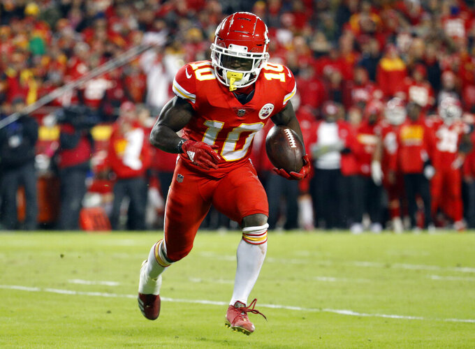 "FILE - In this Dec. 13, 2018, file photo, Kansas City Chiefs wide receiver Tyreek Hill (10) runs with the ball during the first half of the team's NFL football game against the Los Angeles Chargers in Kansas City, Mo. The Chiefs are investigating an incident in which Hill was involved in a domestic battery episode in suburban Kansas City earlier this week. The team said in a statement to The Associated Press that it was aware of a police report filed Thursday, March 14, by the Overland Park Police Department that lists Hill's address and identifies a juvenile as the victim. Hill's fiancee, Crystal Espinal, is identified among ""others involved."" (AP Photo/Charlie Riedel, File)"
